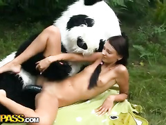 Man in panda costume fucking girl alfresco