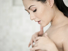 Cassie Laine gets into shower and masturbates